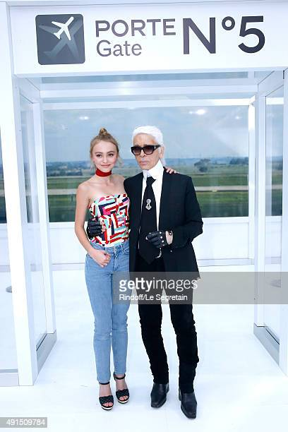 Lily Rose Depp and Karl Lagerfeld pose after the Chanel show as part of the Paris Fashion Week Womenswear Spring/Summer 2016 on October 6 2015 in...