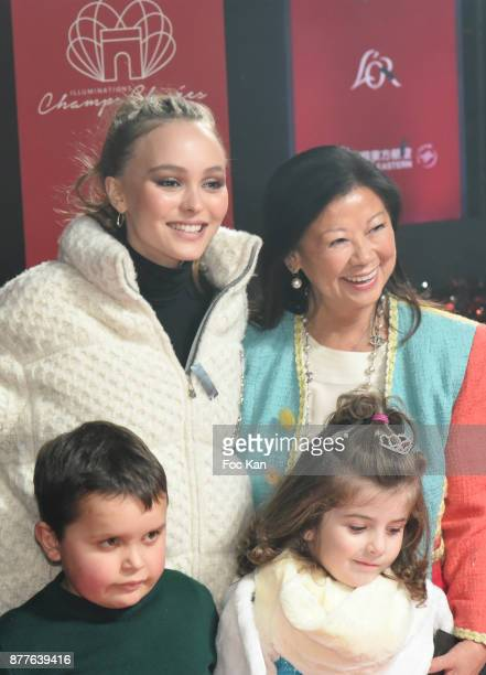 Lily Rose Depp and mayor of 8th district of Paris Jeanne d'Hauteserre attend Christmas Lights Launch On The Champs Elysees on November 22 2017 in...