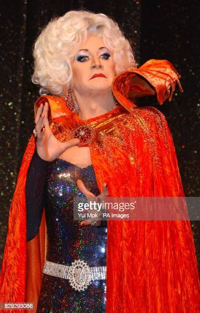 Lily Savage as the Wicked Queen poses for photographers on stage during a photocall for Snow White and the Seven Dwarfs at the Victoria Palace...