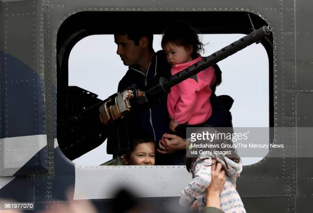 Lily Sherback peeks in at Aiden Berk as he tours the Consolidated B24 Liberator Witchcraft with his father Jon Berk and his sister Kate at the Wings...