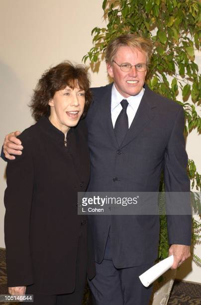Lily Tomlin & Gary Busey during 2003 Women In Film Crystal + Lucy Awards - Show at Century Plaza Hotel in Los Angeles, California, United States.