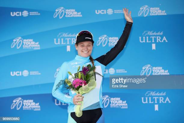 Lily Williams of the United States riding for Hagens Berman/Supermint stands on the stage after being awarded the most courageous rider jersey...