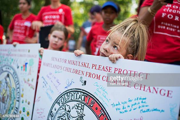 Lilyana Distler of Waldorf Md holds a sign during a playin protest by kids and mothers in Upper Senate Park organized by Moms Clean Air Force July 7...
