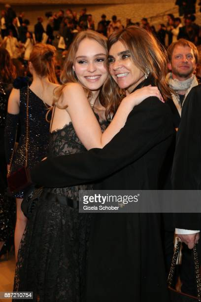 LilyRose Depp and Carine Roitfeld during the Chanel 'Trombinoscope' collection Metiers d'Art 2017/18 show at Elbphilharmonie on December 6 2017 in...