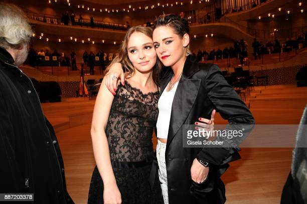 """Lily-Rose Depp and Kristen Stewart during the Chanel """"Trombinoscope"""" Collection des Metiers d'Art 2017/18 photo call at Elbphilharmonie on December..."""
