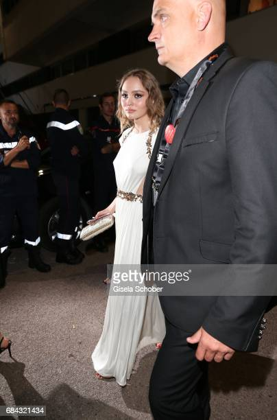 LilyRose Depp daughter of Johnny Depp leaves the Ismael's Ghosts screening and Opening Gala during the 70th annual Cannes Film Festival at Palais des...