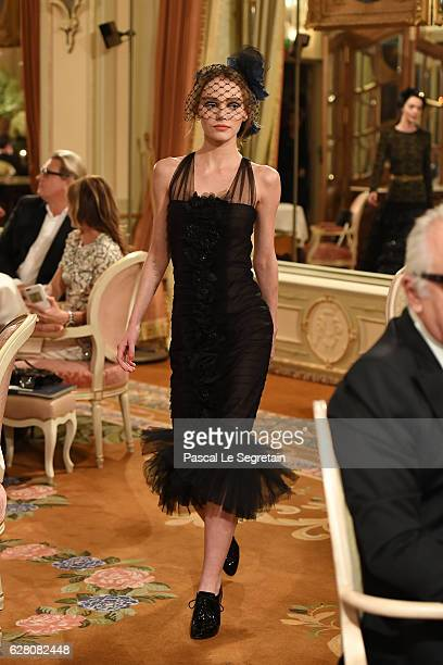 LilyRose Depp walks the runway during Chanel Collection des Metiers d'Art 2016/17 Paris Cosmopolite show on December 6 2016 in Paris France