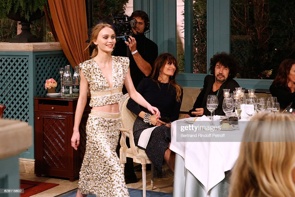 Lily-Rose Depp walks the runway in front of Caroline de Maigret and Yarol Poupaud during the 'Chanel Collection des Metiers d'Art 2016/17 : Paris Cosmopolite'