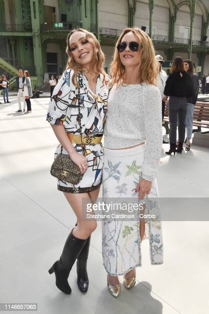 Lily-Rose Depp with her mother Vanessa Paradis attend the Chanel Cruise Collection 2020 : Front Row At Grand Palais on May 03, 2019 in Paris, France.
