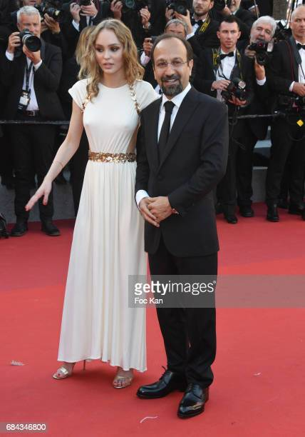 LilyRose DeppÊand Asghar Farhadi attend the 'Ismael's Ghosts ' screening and Opening Gala during the 70th annual Cannes Film Festival at Palais des...