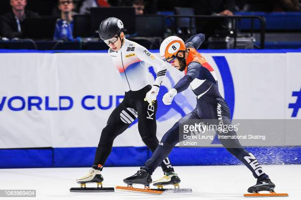 Lim Hyojun of Korea skates over the finish line before Sjinkie Knegt of the Netherlands to finish first in the men's 5000m heat 2 semifinal during...