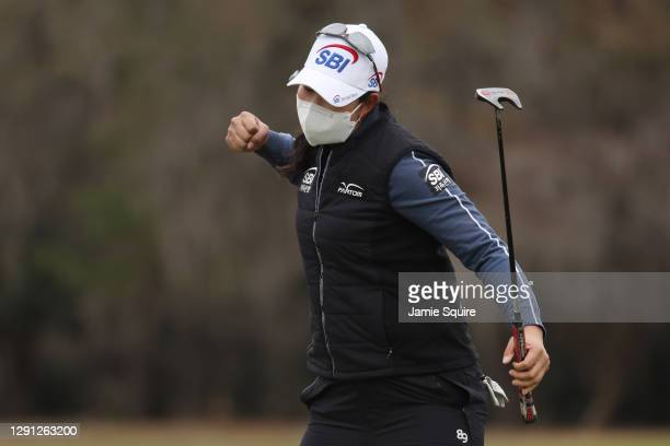 Lim Kim of Korea celebrates after making a birdie on the 18th green during the continuation of the final round of the 75th U.S. Women's Open...