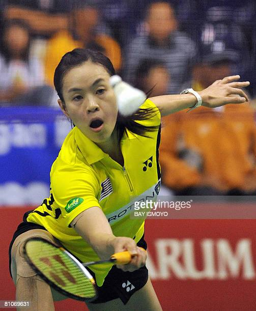 Lim Pek Siah of Malaysia stretches to reach a return against Satoko Suetsuna of Japan during their woman's singles match at the Uber Cup badminton...