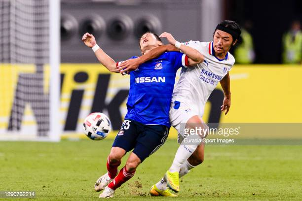 Lim Sanghyub of Suwon Samsung battles for the ball with Teruhito Nakagawa of Yokohama Marinos during the AFC Champions League Round of 16 match...