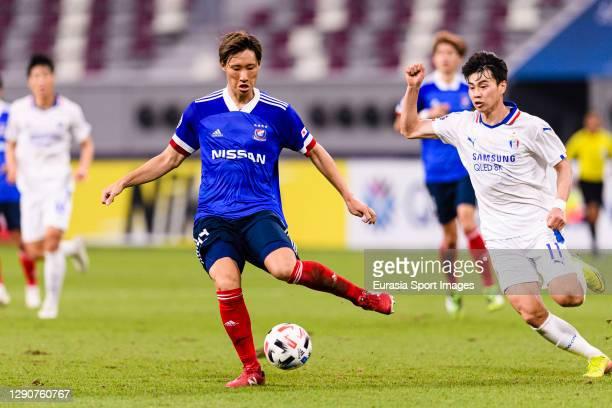 Lim Sanghyub of Suwon Samsung chases Shinnosuke Hatanaka of Yokohama Marinos during the AFC Champions League Round of 16 match between Yokohama...