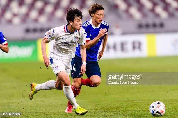 Lim Sanghyub of Suwon Samsung is chased by Shinnosuke Hatanaka of Yokohama Marinos during the AFC Champions League Round of 16 match between Yokohama...