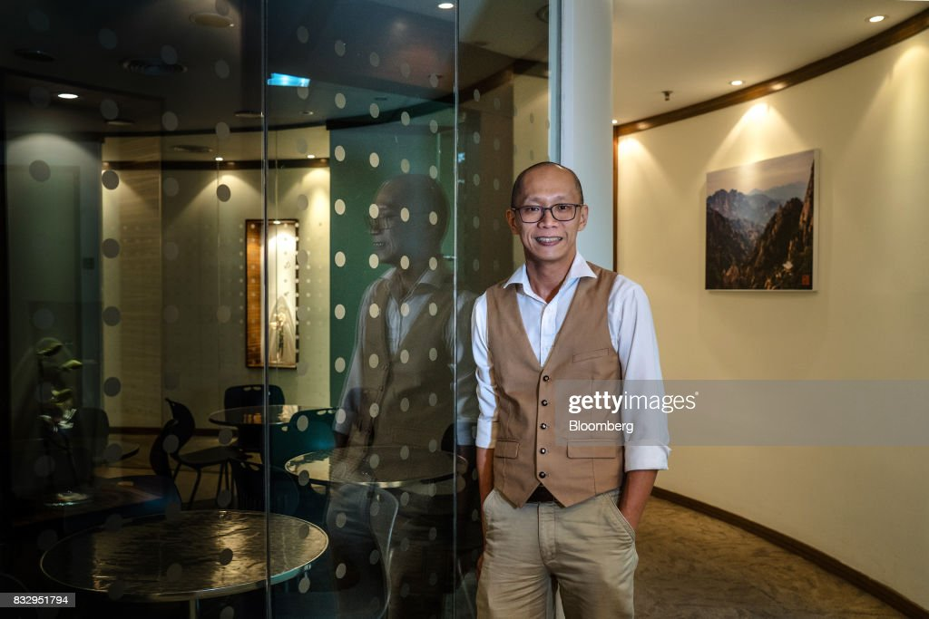 Lim Tze Cheng, chief executive officer of Inter-Pacific Asset Management Sdn., poses for a portrait in his office in Kuala Lumpur, Malaysia, on Tuesday, Aug. 15, 2017. Lim has been buying Malaysian technology and manufacturing stocks that he thinks will increase profit over the long term, betting that the rally in technology has several years to run. Photographer: Sanjit Das/Bloomberg via Getty Images