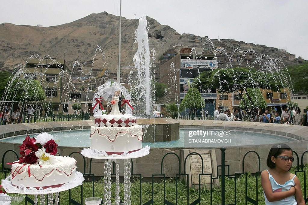 A girl stands next to wedding cakes at a mass wedding celebrated 14 February 2007 in Lima, during St. Valentine's day. AFP PHOTO/Eitan ABRAMOVICH