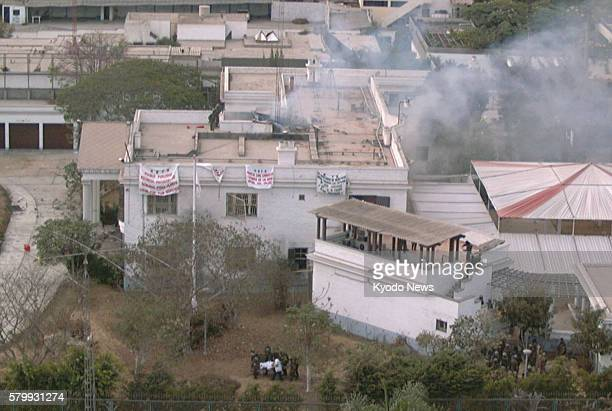 Lima Peru File photo taken April 22 shows the then residence of the Japanese ambassador in Lima from which smoke is coming after the Peruvian...
