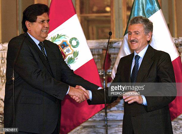Italian Foreign Minister Massimo D'Alema shakes hands with Peruvian President Alan Garcia at the Government Palace in Lima 04 January 2007 D'Alema is...