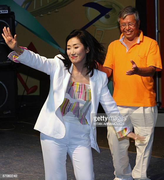 Japanesse citizen and bussineswoman Satomi Kataoka exPeruvian president Alberto Fujimori's girlfriend dances next to Santiago Fujimori Alberto...