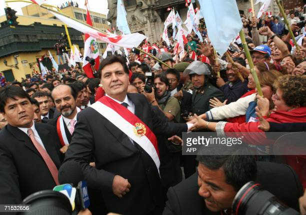 Newly Peru's President Alan Garcia waves to supporters after swearing in Lima 28 July 2005 Garcia a social democrat swears as president for the...
