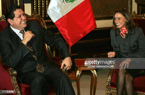 Peruvian President Alan Garcia jokes with Colombian Foreign Affairs Minister Maria Consuelo Araujo at the Government Palace in Lima August 28 2006...