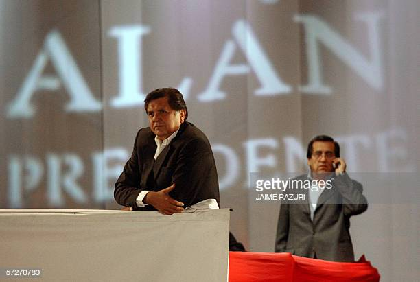 Peruvian presidential candidate Alan Garcia of the social democratic APRA party watches his supporters while the party's General Secretary Jorge del...