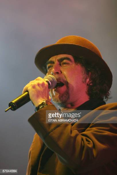 Spanish singer and songwriter Joaquin Sabina performs during a concert in Lima 09 March 2005 AFP PHOTO/EITAN ABRAMOVICH