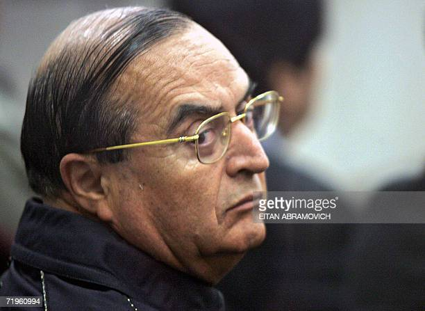 Vladimiro Montesinos exright hand of ex Peruvian President Alberto Fujimori looks at his lawyer Estela Valdivia during a trial session at Callao...