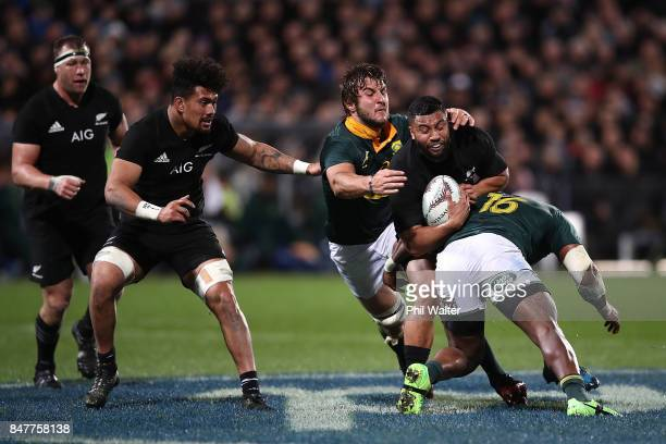 Lima Sopoaga of the All Blacks is tackled during the Rugby Championship match between the New Zealand All Blacks and the South African Springboks at...