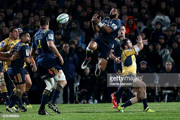 Lima Sopoaga of the Highlanders attempts to take the high ball during the Super Rugby round ten match between the Highlanders and Brumbies at Rugby...