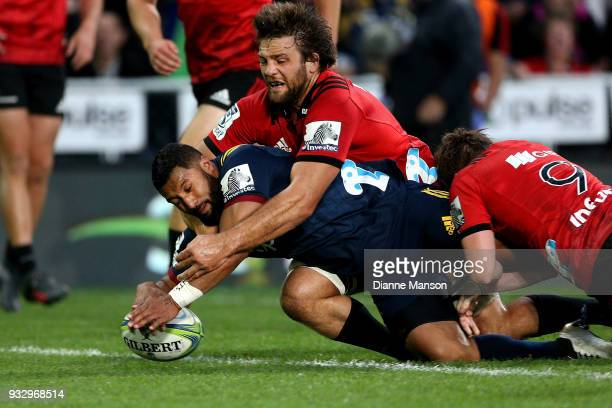 Lima Sopoaga of the Highlanders dives over to score a try during the round five Super Rugby match between the Highlanders and the Crusaders at...