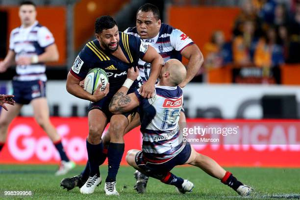 Lima Sopoaga of the Highlanders is tackled by Billy Meakes of the Rebels during the round 19 Super Rugby match between the Highlanders and the Rebels...