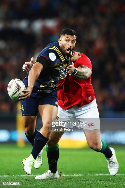 Lima Sopoaga of the Highlanders offloads the ball during the match between the Highlanders and the British Irish Lions at Forsyth Barr Stadium on...