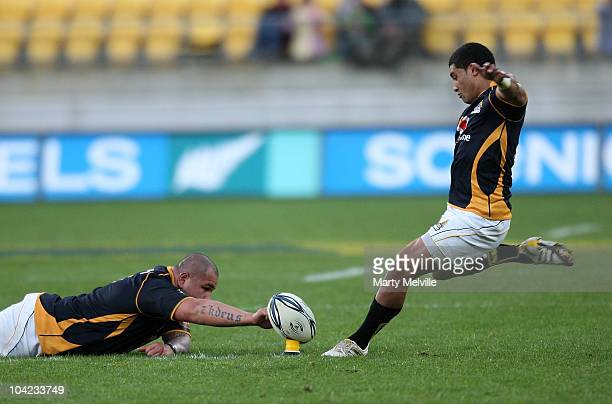 Lima Sopoaga of the Lions kicks a penalty with the help of team mate John Schwalger during the round eight ITM Cup match between Wellington and...