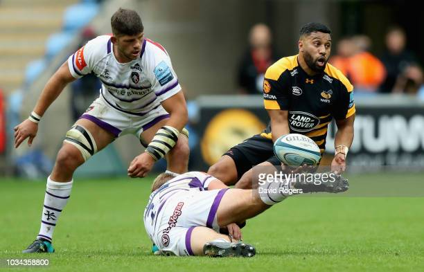 Lima Sopoaga of Wasps is tackled by Tom Youngs during the Gallagher Premiership Rugby match between Wasps and Leicester Tigers at the Ricoh Arena on...