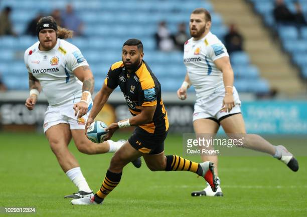 Lima Sopoaga of Wasps off loads the ball during the Gallagher Premiership Rugby match between Wasps and Exeter Chiefs at Ricoh Arena on September 8...