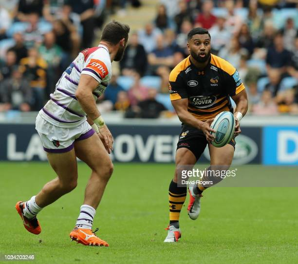 Lima Sopoaga of Wasps takes on Adam Thompstone during the Gallagher Premiership Rugby match between Wasps and Leicester Tigers at the Ricoh Arena on...