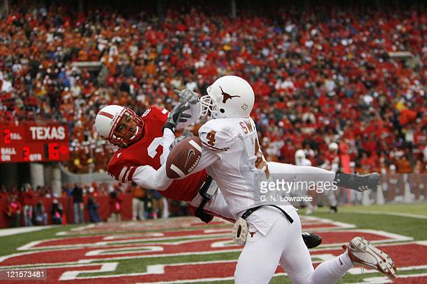 Limas Sweed of Texas battles with Cortney Grixby for the ball during action between the Texas Longhorns and Nebraska Cornhuskers on October 21 2006...