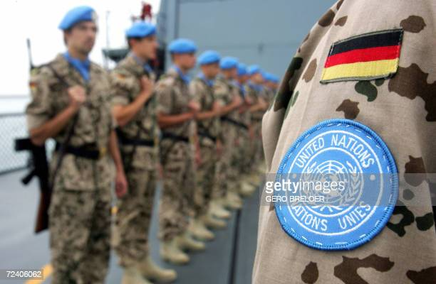 Soldiers of the German armed forces Bundeswehr taking part in the UNIFIL Maritime Task Force stand on their frigate MecklenburgVorpammern to welcome...