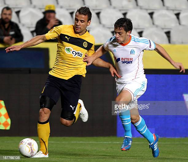 AEL Limassol's forward Orlando Sa challenges Marseille's defender Lucas Mendes during the UEFA Europa League group C football match between AEL...
