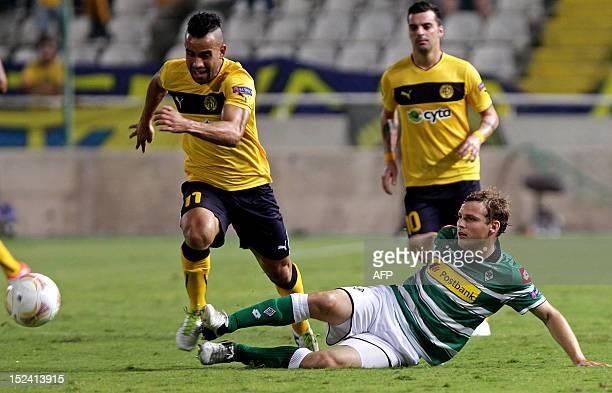 AEL Limassol's midfielder Edmar challenges Borussia Monchengladbach's defender Tony Jantschke during their UEFA Europa League group C football match...