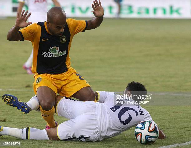 AEL Limassol's player Luciano Bebe fights for the ball with Tottenham Hotspur's defender Kyle Naughton during their 2014 UEFA Europa League Playoff...