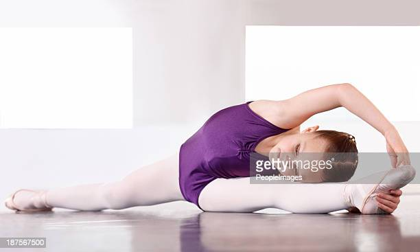limbering up before the recital - leotard stock photos and pictures