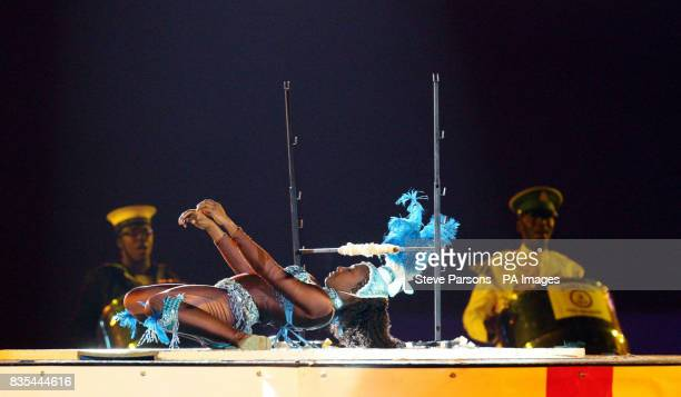 A Limbo Dancer performs with the Trinidad and Tobago Defence Force Steel Orchestra at the Windsor Castle Royal Tattoo in the grounds of the Castle in...