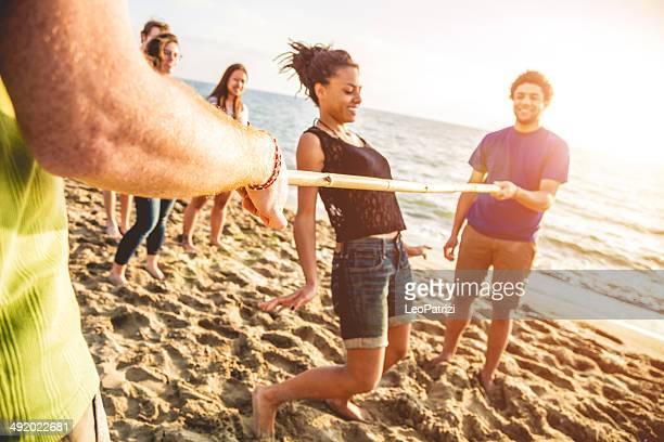 Limbo game on the beach