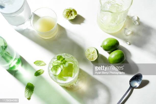 lime and soda cocktail preparation, overhead view - 息抜き ストックフォトと画像
