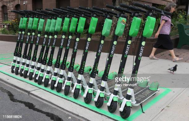 Lime electric scooters part of an escooter test program are lined up on a street corner on June 17 2019 in Hoboken New Jersey