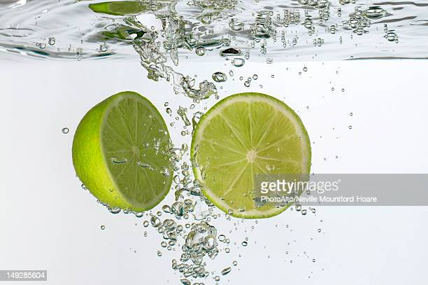 Lime halves submerged in water